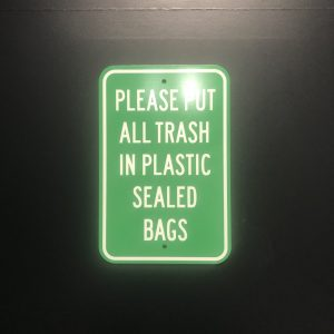 instruction sign for rental trash and recycling