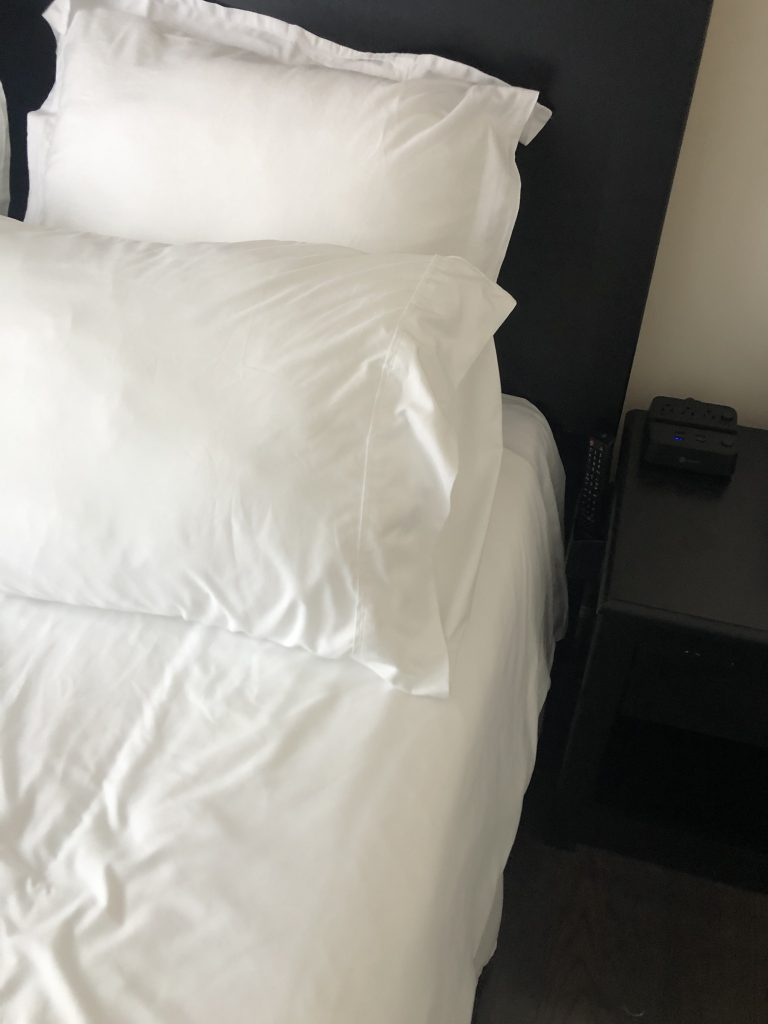 Smart tv remote holder next to the bed